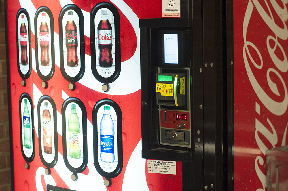 NAAZ MODAN/THE HOYA All 95 Coca-Cola vending machines on the main campus and law center have been upgraded to be compatible with payments by credit card, Apple Pay or Google Wallet in addition to payments by cash and GoCard.