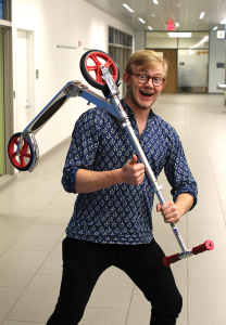 ALEXANDER BROWN/THE HOYA Cannon Warren (SFS '14) uses his scooter to navigate campus.