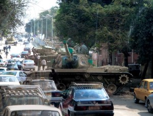 COURTESY MICHELLE SAKS En route to the airport, Michelle Saks (COL '12) witnessed a tank rolling down a crowded street as she left Cairo for Qatar with her GU peers on Monday. The students' academic arrangements remain uncertain.