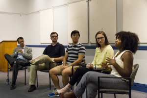 """ALEXANDER BROWN/THE HOYA Evan Hollander (SFS '14), Nate Tisa (SFS '14), Kyle Zhu (SFS '14), Lizzy MacGill (COL '14) and Aya Waller-Bey (COL '14) talk at """"Georgetown in FIve Years: A Conversation With Student Leaders."""""""