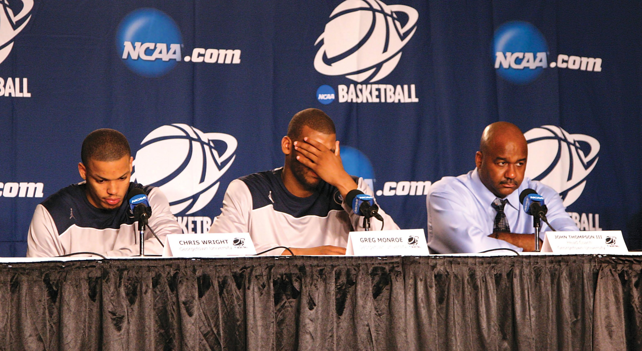 Chris Wright, Greg Monroe and Head Coach John Thompson III look dejected at the postgame press conference after the third-seeded Hoyas' 97-83 loss to 14th-seeded Ohio in the first round of the NCAA tournament.