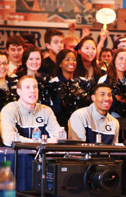 CHRIS GRIVAS/THE HOYA Junior forward Nate Lubick (left) and sophomore forward Otto Porter Jr. look on Sunday in Leo's prior to the announcement of their team's No. 2 seed.