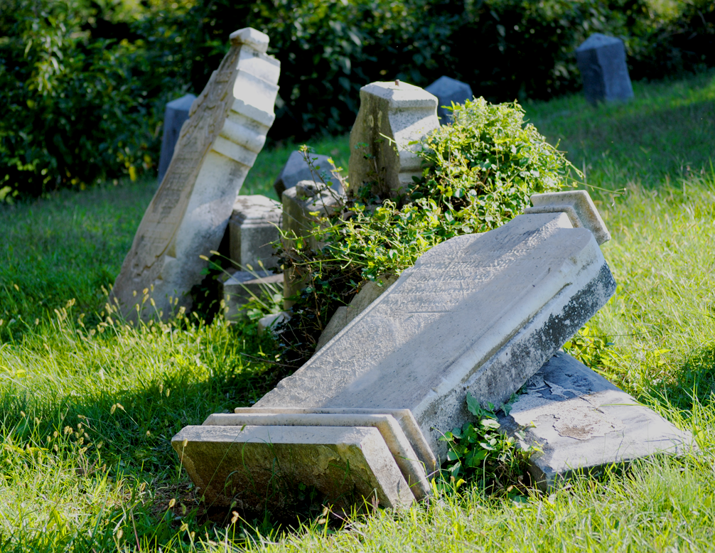 MICHELLE CASSIDY/THE HOYA Fallen tombstones at Holy Rood reflect the oft-overlooked cemetery's long history, which in recent years has been marked by neglect.