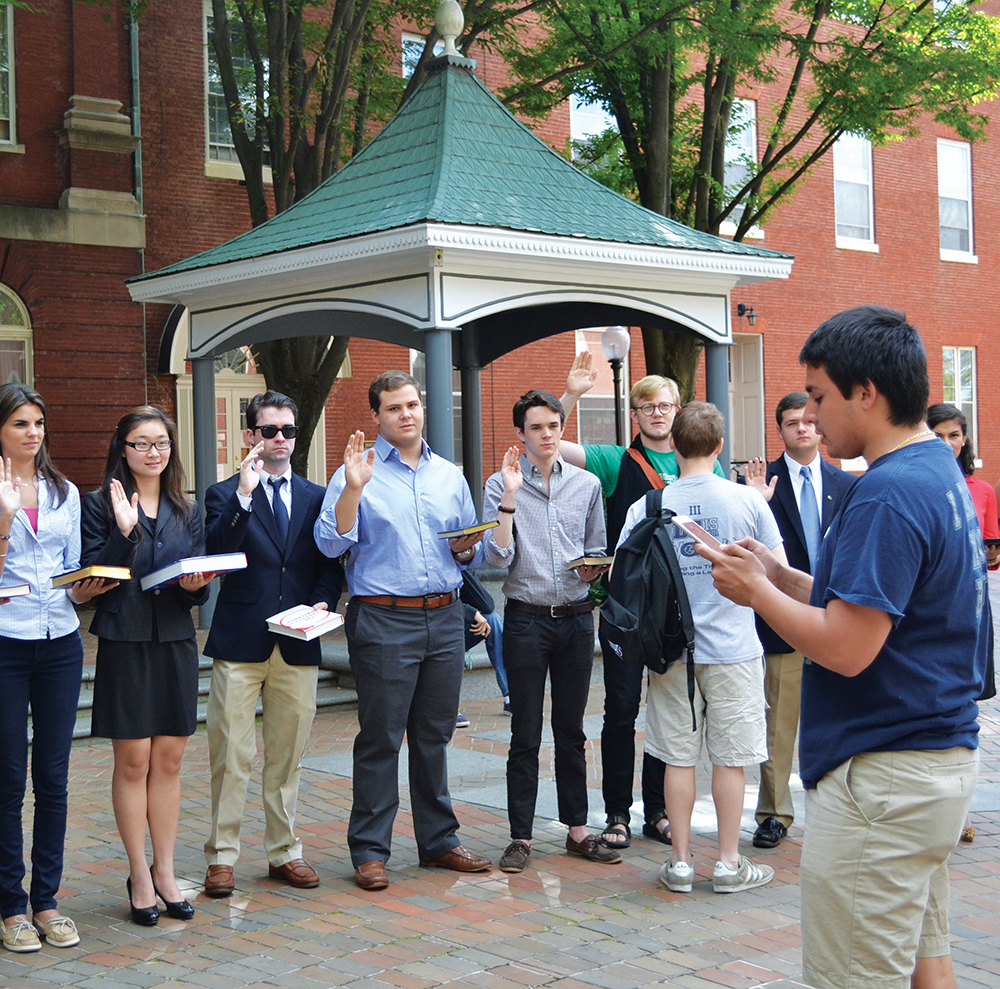 ERICA WONG/THE HOYA Georgetown University Student Association senators took their oaths of office Sunday afternoon in Dahlgren Quad. The election Thursday had record turnout with 47 percent of undergraduate students voting.