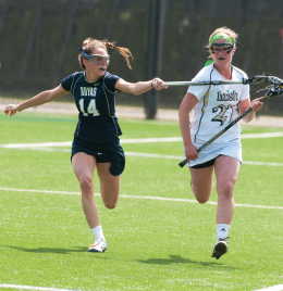 COURTESY GRANT TOBIN/THE OBSERVER Senior attack Dina Jackson scored to knot things up at 8-8 Sunday before the game slipped away.