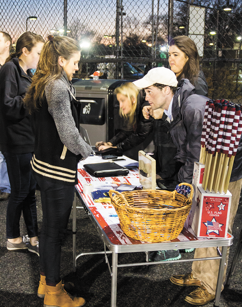 NATASHA THOMSON/THE HOYA Adam Mortillaro (COL '13) helped sell concessions to benefit Dog Tag Bakery at the men's rugby fundraiser at MultiSport Facility on Friday.
