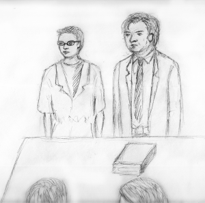 MICHELLE XU/THE HOYA Danny Milzman and his lawyer at his original detention hearing Tuesday.
