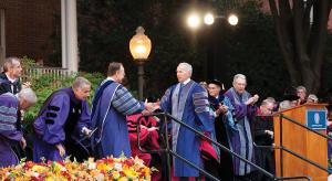 MICHELLE XU/THE HOYA University President John J. DeGioia thanks Frank McCourt (CAS '75) at the ceremony honoring McCourt's $100 million donation to the university in October.