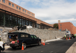 MICHELLE XU/THE HOYA Construction is continuing on the Healey Family Student Center in New South, which will open in September. The center's auxiliary projects, The Corp's Hilltoss salad shop and the university's student pub, have been delayed to fully open later in the semester.