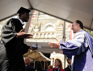 GUHOYAS Green (COL '12) received his degree in English with a minor in theology from Georgetown University President John J. DeGioia.