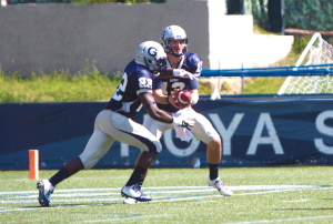 Julia Hennrikus/The hoya Junior quarterback Kyle Nolan threw for a touchdown and rushed for another in Saturday's 17-3 win over Brown. Junior running back Jo'el Kimpela rushed for a career-high 104 yards on 18 carries.