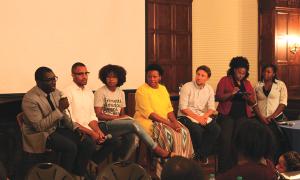 CHARLIE LOWE/THE HOYA Jamelle Bouie of Slate, Brandon Anderson (COL '15), Deloris Wilson (LAW '16), Katrina Gamble of the Leadership Center for the Common Good, Jiva Manske of Amnesty International and Black Student Alliance members.