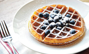 COURTESY FACEBOOK Mintwood is a modern hipster bistro that serves impressive food at every meal. The Belgian waffles are powdered with sugar and served with fresh fruit toppings, making for a refreshing, sugary brunch.