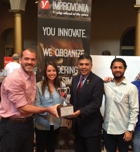 "COURTESY ANDREW GENUNG The Improvonia team accepts their ""Best Unfunded Startup"" at D.C. TechDay from Congressman Tony Cardenas."