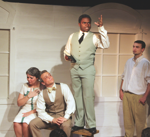 """ARIANA TAFTI FOR THE HOYA Kathleen Hill (SFS '15), Peter Fanone (COL '15), Josh Street (COL '15) and Tim Lyons (COL '15) in a heated courtroom scene in Mask & Bauble's """"Inherit the Wind."""""""