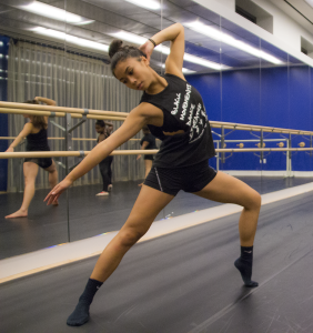 DANIEL SMITH/THE HOYA Stefanie Palencia (COL '15) stretches out during dance rehearsal for Black Movements Dance Theatre's fall concert, Paradigm.