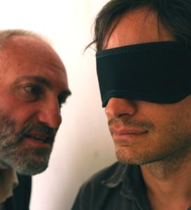 "Courtesy Nasser Kalaji Kim Bodnia as the interrogator and Gael García Bernal as Maziar Bahari in Jon Stewart's directorial debut ""Rosewater"" about Bahari's experience."