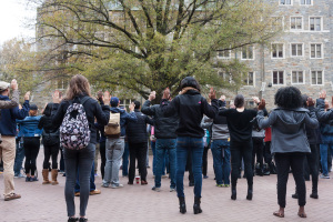 MICHELLE XU/THE HOYA Students gathered for a silent demonstration in Red Square at 12:28 p.m. on Tuesday.
