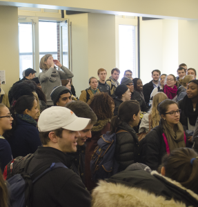 DAN GANNON/THE HOYA Students marched from Sellinger Lounge to Hoya Court in solidarity with Aramark workers seeking better conditions.