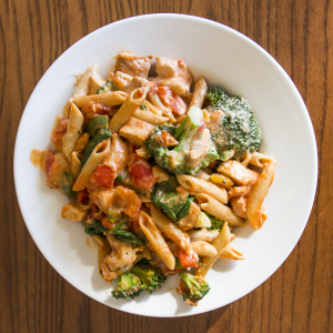 Add lean meat and extra vegetables, and ask for a little less pasta.
