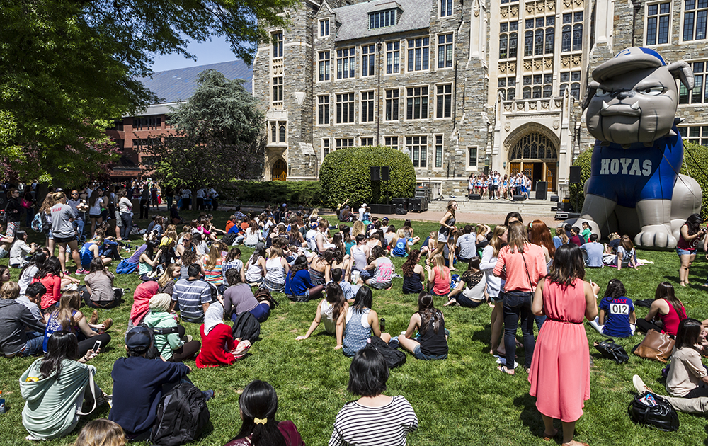 FILE PHOTO ALEXANDER BROWN Students listen to a capella performances on Copley Lawn during Georgetown Day, the annual campus-wide celebration of the end of spring semester.