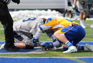 FILE PHOTO: CLAIRE SOISSON/THE HOYA Faceoff specialist and graduate student midfielder Gabriel Mendola has a .490 percentage at the faceoff X this season. Mendola has seen limited minutes in recent games due to the repercussions of physical play at the X.