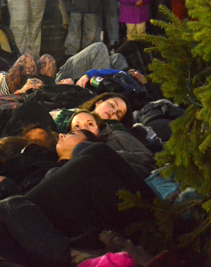 COURTESY MESBAH UDDIN A group of students performed a die-in during the annual Christmas tree lighting ceremony in Dahlgren Quad.
