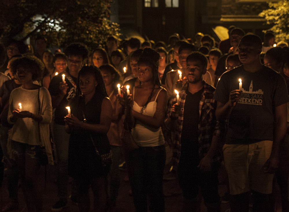 FILE PHOTO: MICHELLE XU/THE HOYA Students gathered for a vigil on the events in Ferguson in Red Square in August.