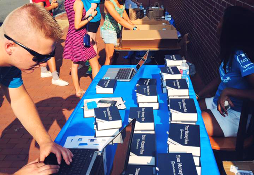 NEXTGENVEST Students signed up to become members of NextGenVest during New Student Orientation the weekend of Aug. 28. The startup advertised their service outside the front gates of the university on O Street.