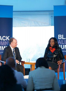 FACEBOOK President DeGioia converses with DCPS Kaya Henderson (SFS '91) at the summit.