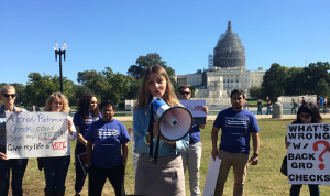 MOLLY COOKE FOR THE HOYA Georgetown Against Gun Violence President Emma Iannini (SFS '16), center, addresses Tuesday's Brady Campaign to Prevent Gun Violence and Generation Progress rally.