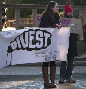 FILE PHOTO: ISABEL BINAMIRA/THE HOYA GU Fossil Free, pictured here at a protest on January 16, circulated a letter written by an alumnus calling for the university to divest.