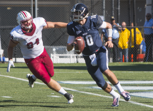 FILE PHOTO: KARLA LEYJA FOR THE HOYA Senior quarterback Kyle Nolan scored a 10-yard rushing touchdown to cut Colgate's lead to 17-10. The Hoyas fell by a score of 17-13.