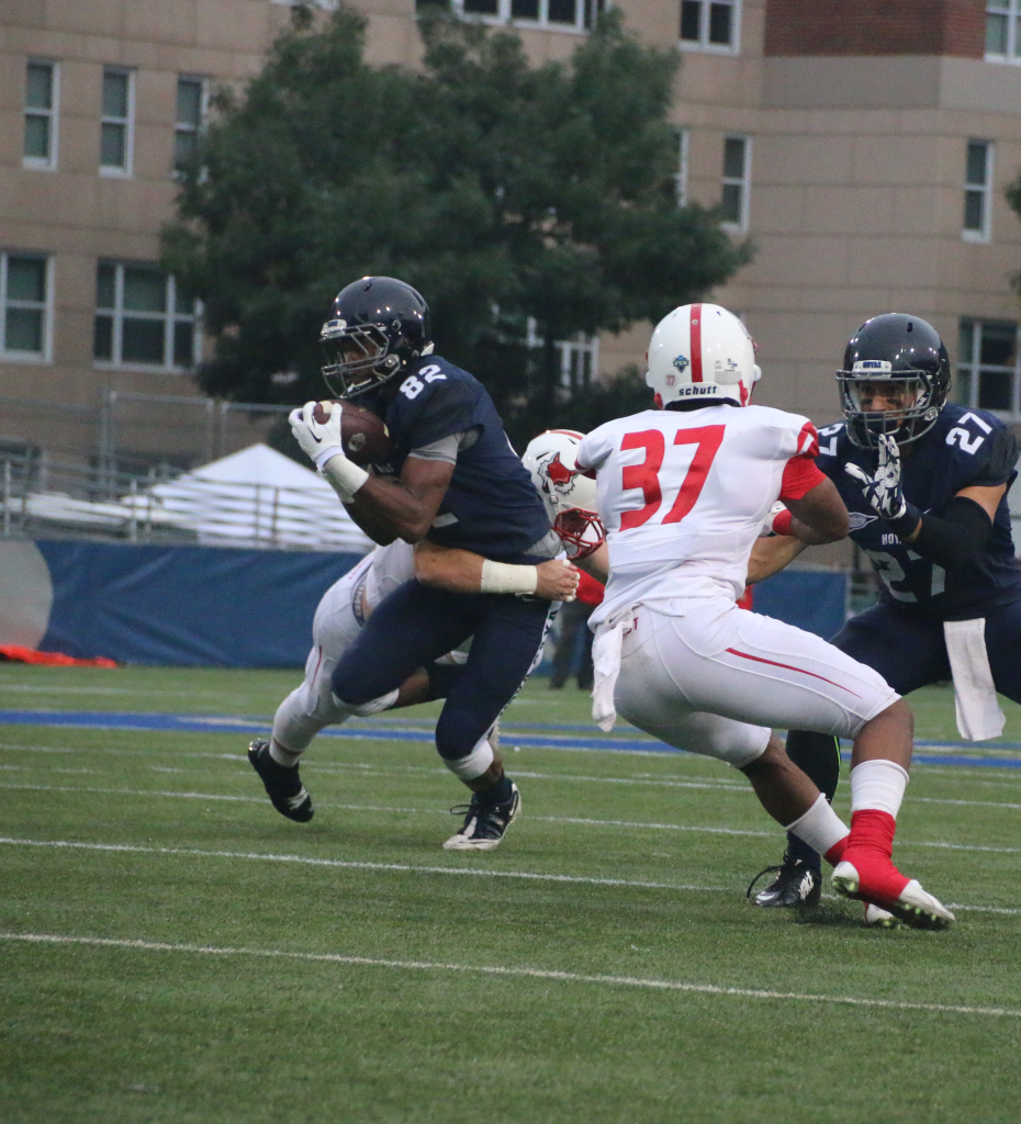FILE PHOTO: ISABEL BINAMIRA/THE HOYA Junior wide receiver Brandon Williams, number 82, caught a touchdown pass in Friday's 31-17 loss to Harvard.