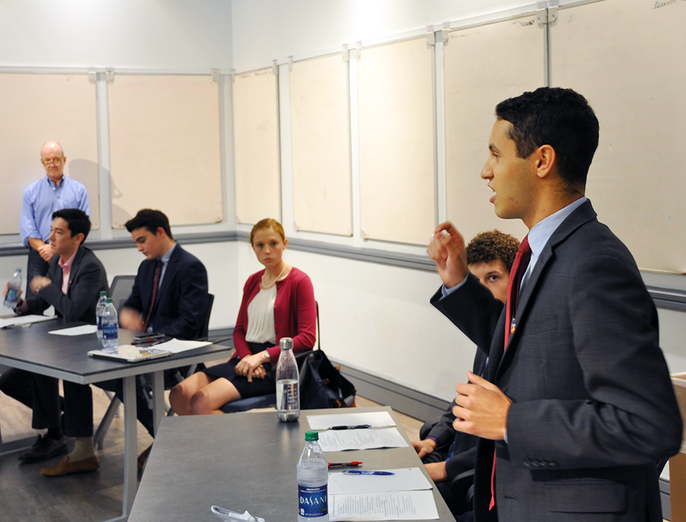 """LUAN TIAN FOR THE HOYA GU College Democrats member Alec Camhi (SFS '20), left, and GU College Republican Peter Hamilton member (SFS '20) represented their respective clubs at the annual """"Freshman Debate."""" Student Democrats have supported Clinton, while Republicans are conflicted over Trump."""