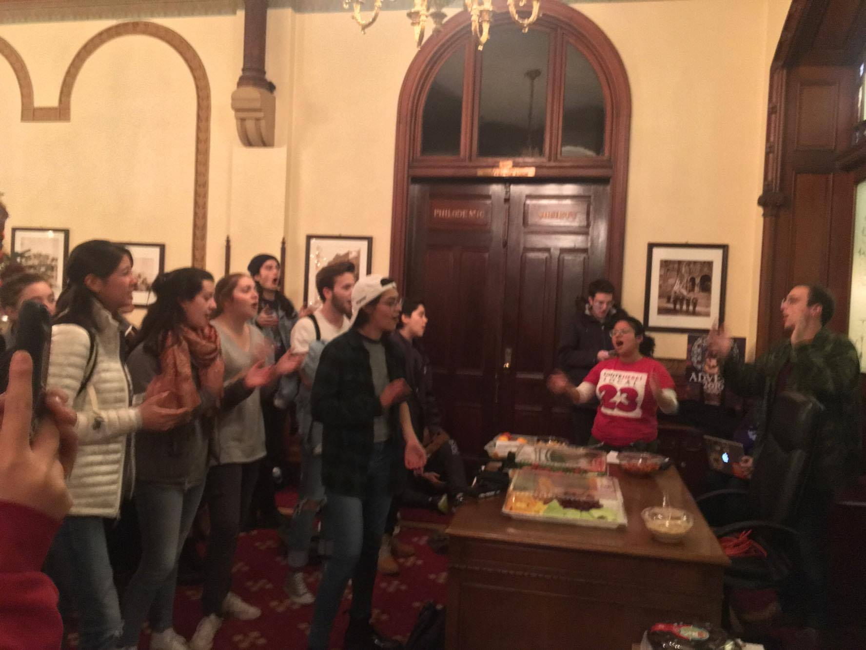 JEANINE SANTUCCCI/THE HOYA Students demonstrated outside University President John J. DeGioia's suite of offices this evening as GSC members met with Chief of Staff Joe Ferrara and Vice President for Student Affairs Todd Olson.
