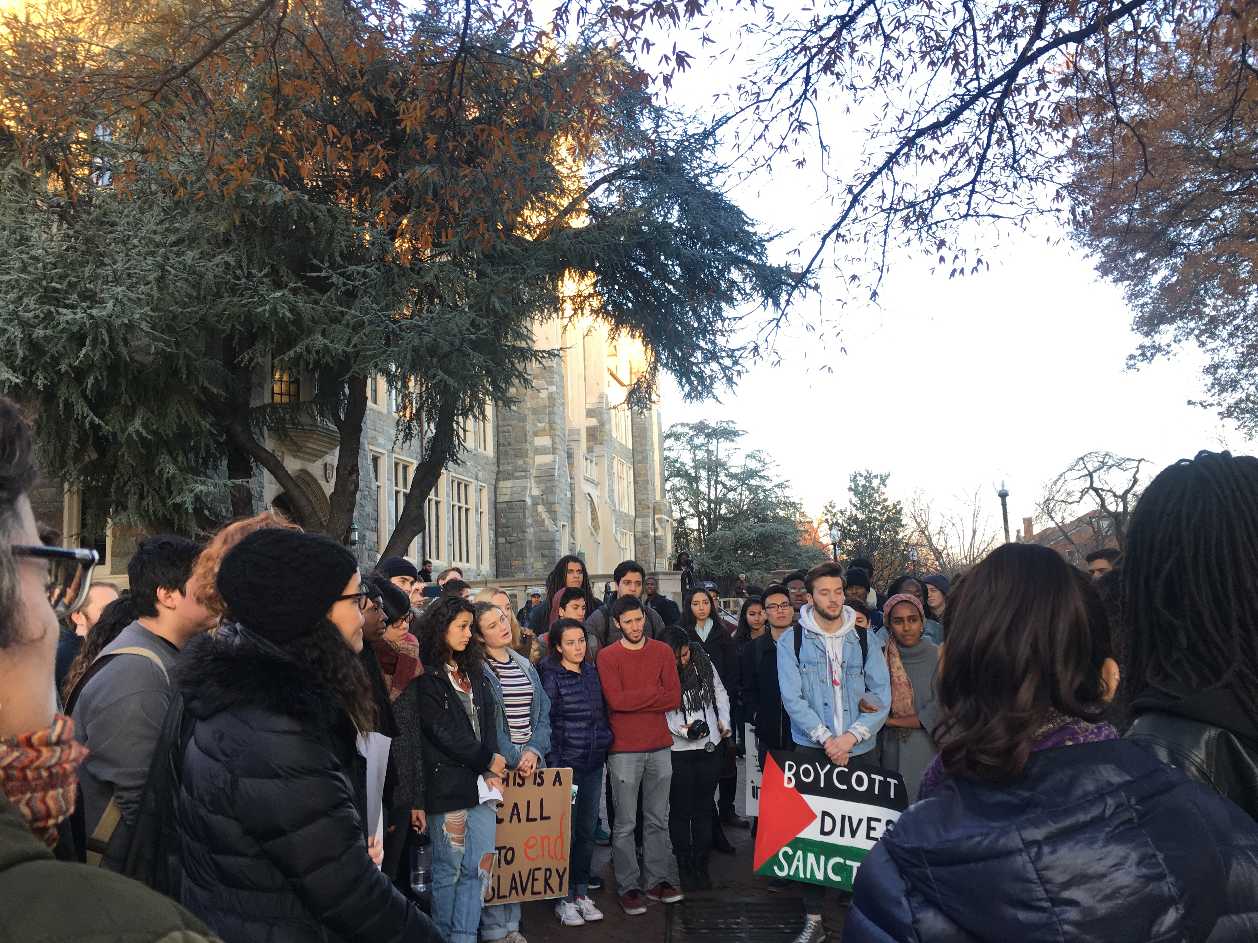 JEANINE SANTUCCI/THE HOYA Students gathered in Red Square on Wednesday before marching to University President John J. DeGioia's office to deliver a letter requesting transparency on the university's endowment.
